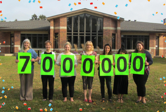 """library staff holding """"7 Million"""" sign"""